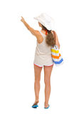Beach woman pointing on copy space . rear view Royalty Free Stock Photography