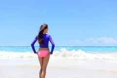 Beach woman in rashguard living a active lifestyle Royalty Free Stock Image