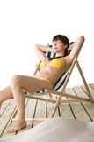 Beach - Woman relax in bikini on deckchair Royalty Free Stock Images