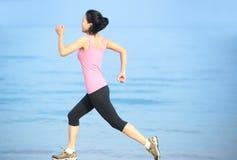 Beach woman runner Stock Images