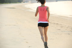 Beach woman running Stock Photos