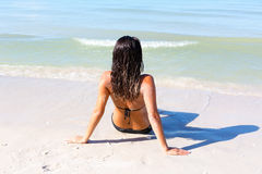 At the beach. Woman sitting at the beach stock images