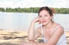 Beach. Woman sitting on a beach during summer Royalty Free Stock Image