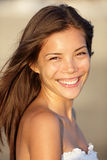 Beach woman smiling. Happy portrait. Beautiful young mixed race Asian / Caucasian woman portrait. Natural smile on beach at sunset Royalty Free Stock Photography