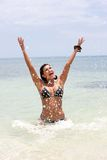 Beach woman splashing Stock Photo