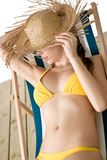 Beach - woman with straw hat in bikini relaxing Royalty Free Stock Photo