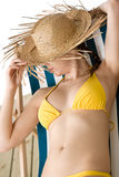 Beach - woman with straw hat in bikini sunbath Stock Photo