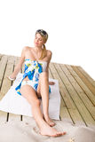 Beach - woman sunbathing with pareo and sunglasses Royalty Free Stock Images