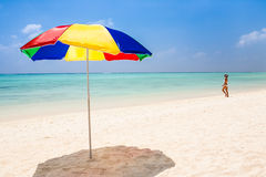 Beach, woman and sunshade Royalty Free Stock Images