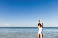 At the beach. Woman with a swimsuit at the beach stock photos