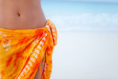 Beach woman wearing a sarong Stock Photos