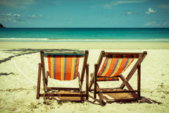 Beach wooden bed on white sand with beautiful blue sea Royalty Free Stock Photos