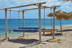 Seascape on Black Sea. Beach wooden canopy and thatched umbrella Stock Photos