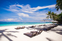 Beach wooden chairs for vacations and relax on Royalty Free Stock Images