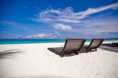Beach wooden chairs for vacations and relax on Stock Images