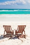 Beach wooden chairs for vacations and relax on Stock Photography