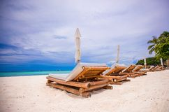 Beach wooden chairs for vacations on tropical Stock Image