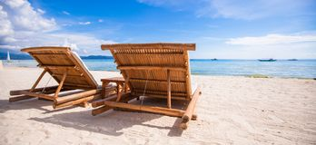 Beach wooden chairs for vacations on tropical Royalty Free Stock Image