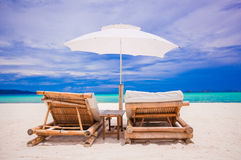 Beach wooden chairs for vacations on tropical Royalty Free Stock Photography