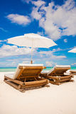 Beach wooden chairs for vacations on tropical Stock Photos