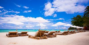 Beach wooden chairs for vacations on tropical Stock Photography