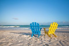 Beach wooden colorful chairs for vacations on Stock Image