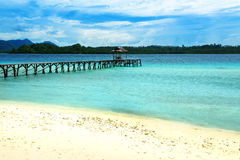 Beach and wooden dock on Bolilanga Island. Togean Islands. Indonesia. Stock Photo
