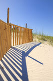 Beach with wooden fence stock image