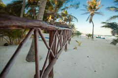 Beach wooden fence on tropical white beach Stock Photos