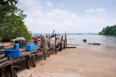 Beach and wooden jetty on Pulau Ubin, Singapore Royalty Free Stock Images