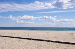 Beach with wooden pathway Royalty Free Stock Photo
