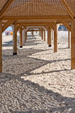 Beach, wooden sun shelters Royalty Free Stock Photos