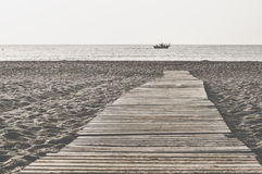 Beach and wooden trail. Gibraltar Stock Photo
