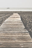 Beach and wooden trail. Gibraltar Stock Photography