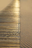 Beach wooden walkway and sand dunes texture Stock Images