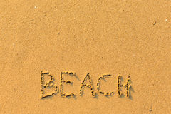Beach - words hand-written on sand beach. Nature. Royalty Free Stock Photo