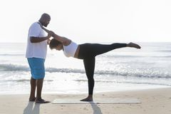 Beach workout by african american couple stock photography
