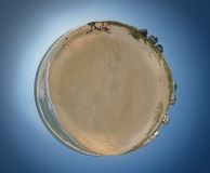 Beach World. Small planet with nothing but water, sand, dunes, and beach houses Stock Photo