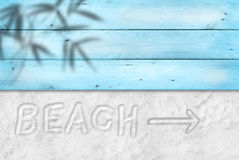 Beach write on sand. Sand, wooden floor, summer vacations sand type Stock Photos