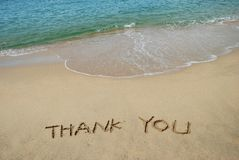 Beach writing. Thanks Message left in the sandy beach Stock Photography