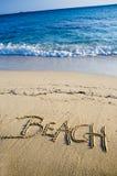 Beach written on the sand Royalty Free Stock Photo