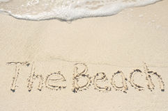 The Beach Written in Sand on Beach Stock Image