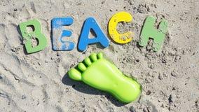 Beach written Stock Photos