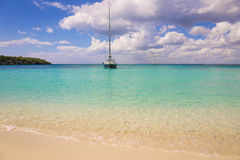 Beach. Yacht on the Caribbean sea Stock Photography