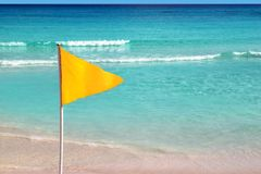 Beach yellow flag weather indication signal. Beautiful beach yellow flag weather indication signal Royalty Free Stock Image