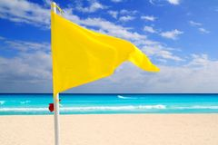 Beach yellow flag weather wind advice Stock Photo