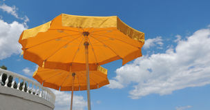Beach yellow umbrellas. Royalty Free Stock Photos