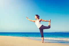 Beach Yoga, Healthy Lifestyle. Healthy Lifestyle Concept, Beautiful young woman stretching practicing yoga on the beach Royalty Free Stock Photo