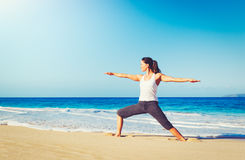 Beach Yoga, Healthy Lifestyle. Healthy Lifestyle Concept, Beautiful young woman stretching practicing yoga on the beach Royalty Free Stock Images
