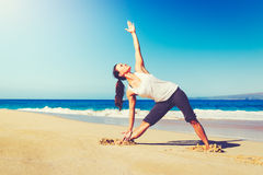 Beach Yoga, Healthy Lifestyle. Healthy Lifestyle Concept, Beautiful young woman stretching practicing yoga on the beach Royalty Free Stock Photography